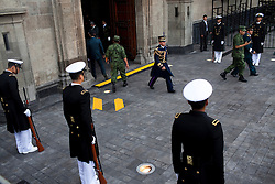 Officer stand outside the presidential palace just before a parade for Mexico's bicentennial celebration, in Mexico City to mark the 200th anniversary of the uprising against Spanish rule which eventually led to their declaration of independence in 1821.