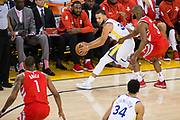 Golden State Warriors guard Stephen Curry (30) handles the ball against the Houston Rockets during Game 3 of the Western Conference Finals at Oracle Arena in Oakland, Calif., on May 20, 2018. (Stan Olszewski/Special to S.F. Examiner)