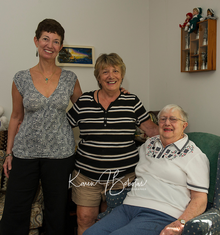 Karen Lukeman, Irene Gordon and Gloria Borchert pose for a photo in Gloria's home on Wednesday afternoon.  Gloria has placed a pre order for her and husband Walter including their favorite dishes from the Jewish Food Festival that will be held on Sunday from 11-2 at the Temple B'nai Israel in Laconia.  (Karen Bobotas/for the Laconia Daily Sun)