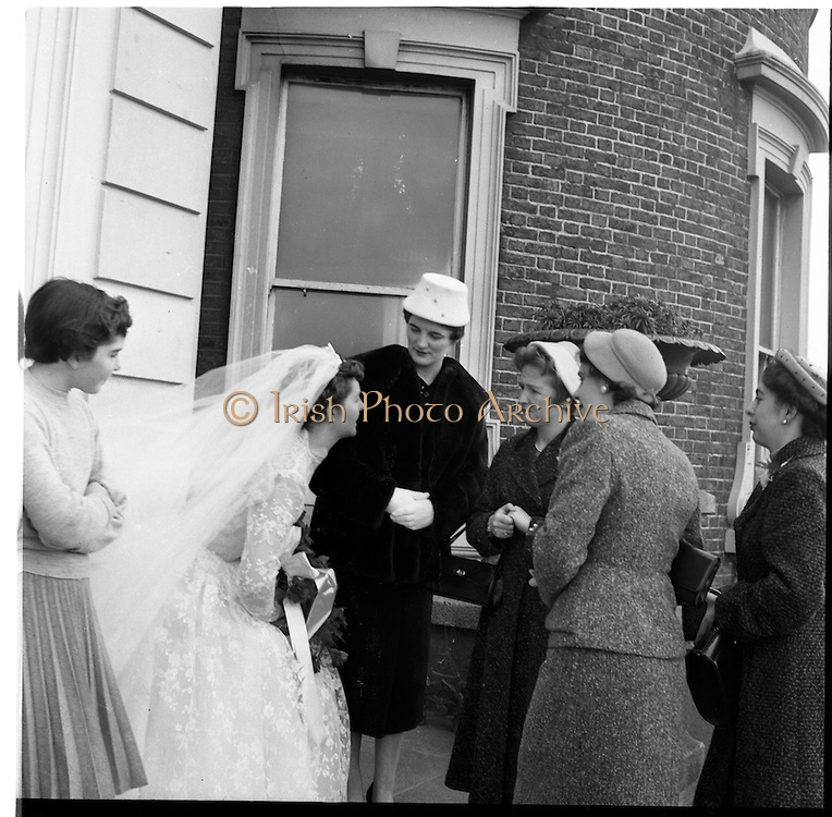 18/02/1957<br /> 02/18/1957<br /> 18 February 1957<br /> Wedding Dr K. Murphy and J. Fitzgerald at St. Mary's Church, Haddington Road and reception at Salthill Hotel, Monkstown. Bride and well-wishers outside the hotel.
