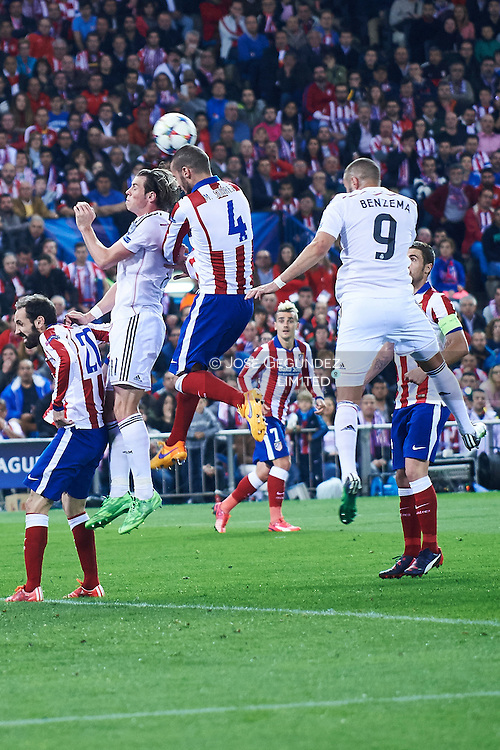 Gareth Bale (Real Madrid F.C.) and Mario Suarez in action during the Champions League, round of 4 match between Atletico de Madrid and Real Madrid at Estadio Vicente Calderon on April 14, 2015 in Madrid, Spain