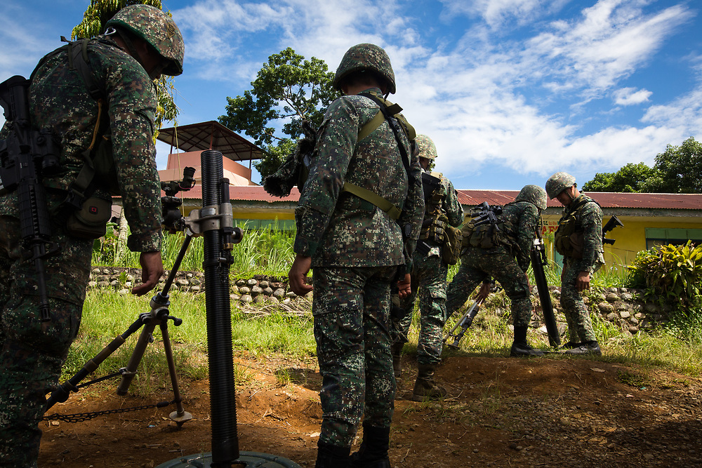 MARAWI, PHILIPPINES - JUNE 9: Philippine marines prepares a mortar trying to attack remaining Islamist rebels during a heavy fight inside Marawi city, southern Philippines on June 9, 2017. Philippine military jets fired rockets at militant positions on Friday as soldiers fought to wrest control of the southern city from gunmen linked to the Islamic State group. (Photo: Richard Atrero de Guzman/NUR Photo)