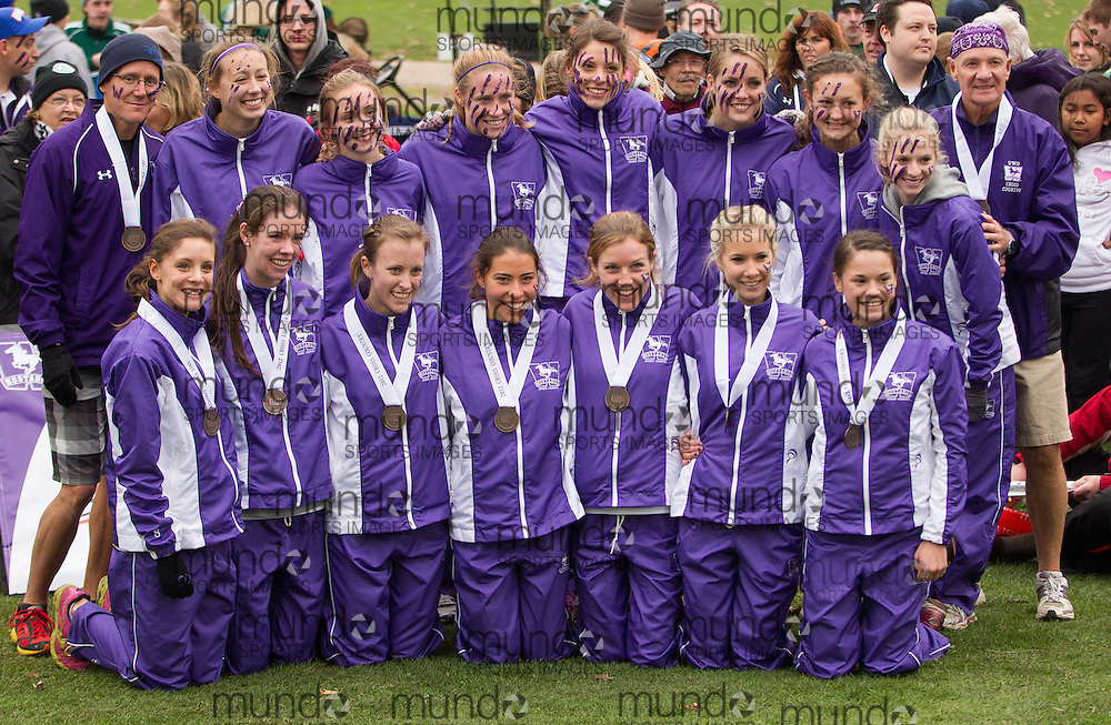 London, Ontario ---2012-11-10--- The Western Mustangs women's team poses with their bronze medals following the 2012 CIS Cross Country Championships at Thames Valley Golf Course in London, Ontario, November 10, 2012. .GEOFF ROBINS Mundo Sport Images