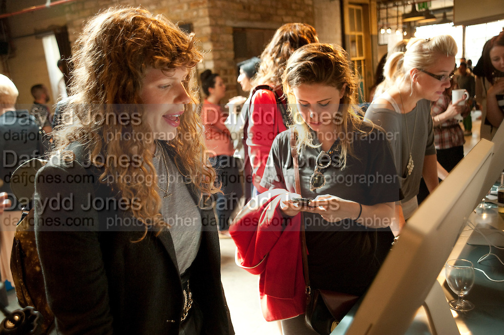 MARGOT BOWMAN; BILLIE JD PORTER;, Design Your Own Timberland breakfast and Autumn/ Winter 2011 preview. Timberland. 1 Fournier St. London. Followed by an art tour by Julia Royce. 8 June 2011. <br /> <br />  , -DO NOT ARCHIVE-© Copyright Photograph by Dafydd Jones. 248 Clapham Rd. London SW9 0PZ. Tel 0207 820 0771. www.dafjones.com.
