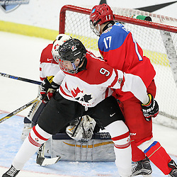 COBOURG, - Dec 19, 2015 -  Gold Metal Game - Russia vs Canada West at the 2015 World Junior A Challenge at the Cobourg Community Centre, ON. Dennis Cholowski #9 of Team Canada West protects the crease during the first period.(Photo: Tim Bates / OJHL Images)