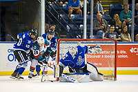 KELOWNA, CANADA - AUGUST 31: Leif Mattson #28 of the Kelowna Rockets is checked behind the net of Dean McNabb #35 by Cage Newans #10 and Remy Aquilon #3 of the Victoria Royals during first period on August 31, 2018 at Prospera Place in Kelowna, British Columbia, Canada.  (Photo by Marissa Baecker/Shoot the Breeze)  *** Local Caption ***