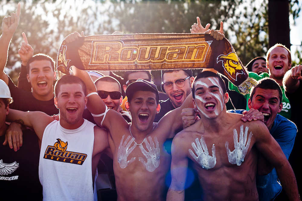 The Rowan University Men's Soccer team cheers on the women's soccer team during a NCAA Division 3 second Round tournament match against Messiah College.
