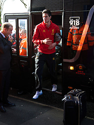 WEST BROMWICH, ENGLAND - Sunday, February 2, 2014: Liverpool's Martin Kelly steps off the team coach as the squad arrive at The Hawthorns ahead of the Premiership match against West Bromwich Albion at the Hawthorns. (Pic by David Rawcliffe/Propaganda)