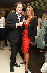 PIERS MORGAN and CELIA WALDEN at a party to celebrate the opening of Maze - a new Gordon Ramsay restaurant at 10-13 Grosvenor Square, London W1 on 24th May 2005.<br />