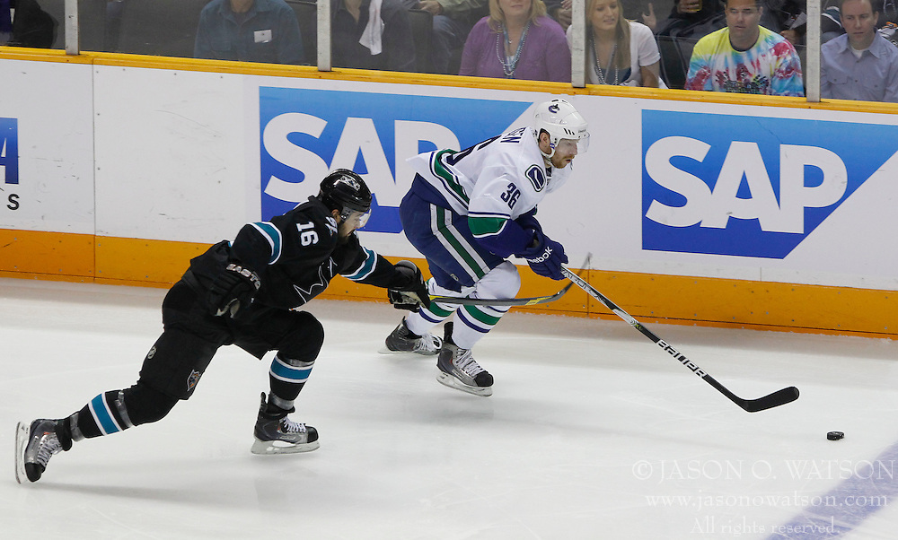 May 22, 2011; San Jose, CA, USA; Vancouver Canucks right wing Jannik Hansen (36) controls the puck in front of San Jose Sharks right wing Devin Setoguchi (16) during the first period of game four of the western conference finals of the 2011 Stanley Cup playoffs at HP Pavilion. Mandatory Credit: Jason O. Watson / US PRESSWIRE