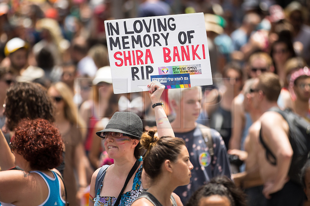 """© Licensed to London News Pictures . 03/06/2016 . Tel Aviv , Israel . Placard commemorating Shira Banki , who was stabbed to death by Yishai Shlissel during Jerusalem Pride in 2015 . Over 100,000 people attend the gay pride parade in Tel Aviv , reported to be the largest such event in the Middle East and Asia . The Israeli government has been accused of using the event as """" pinkwashing """" , marketing the event in order to deflect accusations of poor human rights behaviour . Photo credit: Joel Goodman/LNP"""