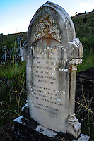 Gravestone at the graveyard in Pilgrim's Rest, an old Gold mining town in South Africa declared a national monument.