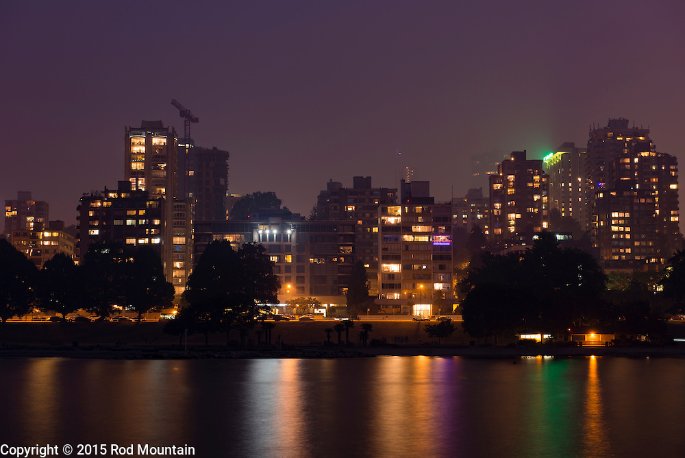Vancouver, BC, Canada - July 5, 2015 - Smoke from recent forrest fires in British Columbia fill the night air in downtown Vancouver.<br />