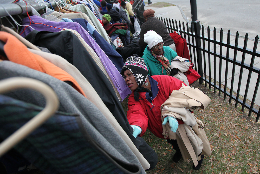 Linda Rivers, 62, of North Charleston looks through racks of coats and jackets Saturday in downtown Charleston at the 16th annual coat and clothing giveaway hosted by state Rep. Wendell Gilliard, former Sen. Robert Ford and Pastor Gordon Cashwell of Without Walls Ministries. The event at Meeting and Harris streets provides clothing and food items to the homeless and other needy people. (ANDREW KNAPP/STAFF)