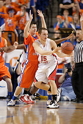 Bullitt East's Hayden Sweat, right, dishes to an open teammate in the first half. Sweat is guarded by Marshall County's Blake Clark. Bullitt East hosted Marshall County in 11th game of  the 2011 PNC/ KHSAA Boys Sweet 16, Friday, March 18, 2011. Photo by Jonathan Palmer