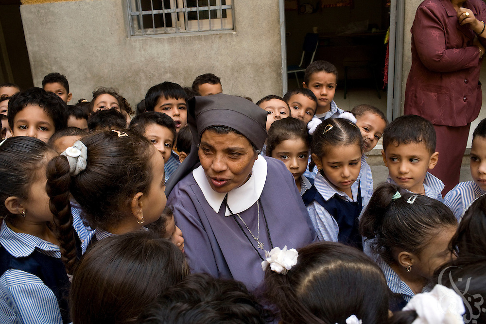 Sister Sara speaks with children at the school for poor children  that she helped found more than 30 years ago with the famous French nun, Sister Emanuel in the Manshiyet Nasser district of the Egyptian capital, Cairo October 16, 2008. The school now provides an education to more than 1200 students from the surrounding slums which are a large garbage collection district.