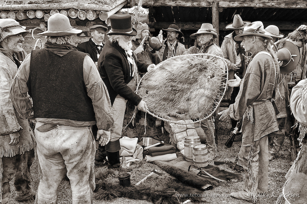 Traders working on a sale or trade in the Mountain Man Rendezvous. Photo taken at historic Fort Bridger in southern Wyoming. Trappers and traders in their authentic gear.