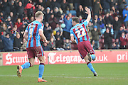 Tom Hopper of Scunthorpe United celebrtates scoring his second  goal for Scunthorpe to go 6-0 up  during the Sky Bet League 1 match between Scunthorpe United and Swindon Town at Glanford Park, Scunthorpe, England on 28 March 2016. Photo by Ian Lyall.