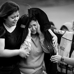 047-Rosa Cedilo (center) is lead away from the scene of a quadruple fatal car crash that killed her pregnant daughter, Kirian Y. Cedillo Cedillo, 21, 4-year-old granddaughter, Joselyn Cedilo, along with two others on Starkey Road in Roanoke, Virginia on Monday afternoon. All were riding in a Mustang which was traveling over the speed limit, lost control, and smashed head-on into an Allied moving van. The driver, Nelson Gomez Amaya, 22, Kirian's fiancee, was driving without a license, and had previously been cited multiple times by police for speeding.