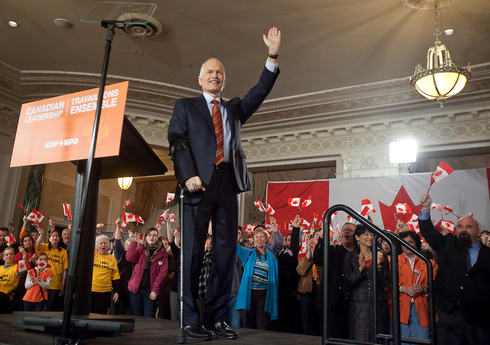 NDP leader Jack Layton waves to the crowd at the NDP's kickoff campaign event in Ottawa, Ontario, March 26, 2011 following the fall of the Conservative government  Friday. Canadians will be heading to the polls May 2.<br /> AFP/GEOFF ROBINS/STR