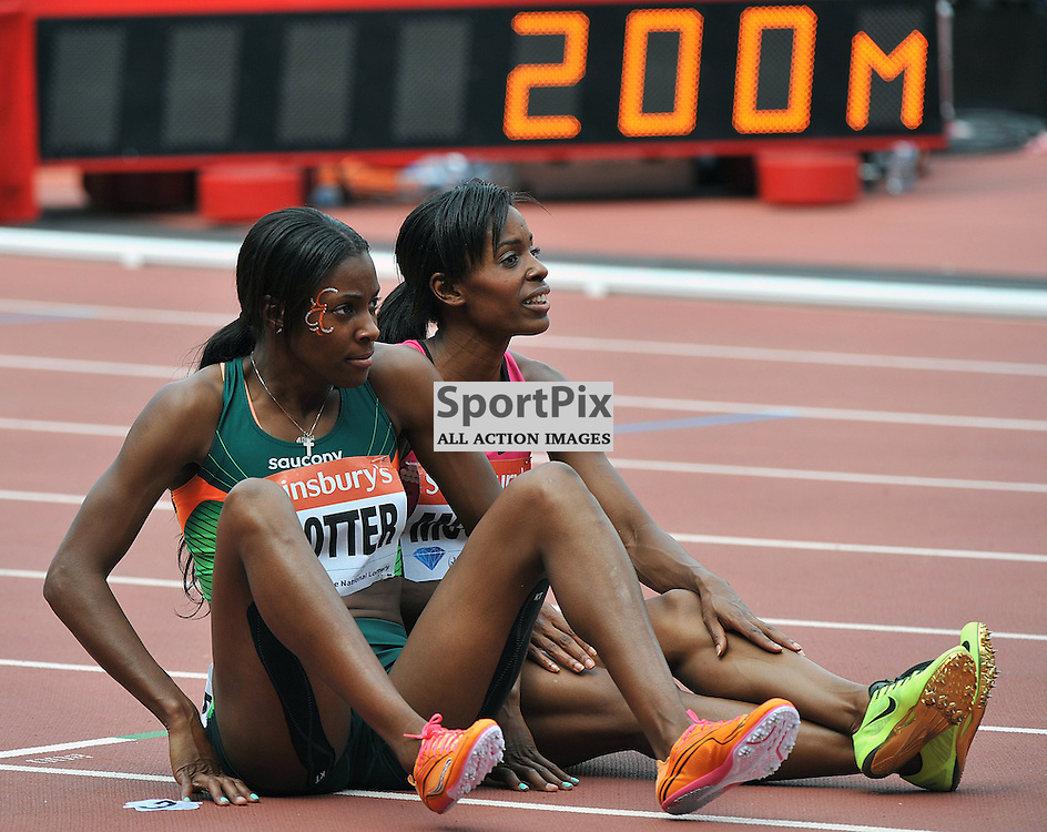 Deedee Trotter and Lashauntes Moore having a sit down after the 200m Final.<br /> At the IAAF Diamond League - Sainsbury's Anniversary Games held at the London Olympic Stadium, Queen Elizabeth Olympic Park, Stratford, London, UK on the 27th July 2013.<br /> WAYNE NEAL | SPORTPIX.ORG.UK