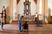 09 JANUARY 2007 - MASAYA, NICARAGUA: People pray in a small Catholic church in Masaya, Nicaragua. Masaya is the center of the Nicaraguan folkloric industry and home of the Masaya Volcano National Park.   PHOTO BY JACK KURTZ