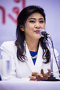 03 MARCH 2013 - BANGKOK, THAILAND: YINGLUCK SHINAWATRA, the Thai Prime Minister, makes the announcement that Pongsapat Pongchareon, her party's candidate for Governor of Bangkok, lost the election. Pongsapat Pongchareon, running on the Pheu Thai ticket, lost the Bangkok's Governor's race to MR Sukhumbhand Paribatra, the incumbent running on the Democrat ticket. Sukhumbhand won the race after scoring a record number of votes, more than 1.2 million to Pongsapat's 1 million. The results were seen as an upset even though Sukhumbhand was the incumbent because all of the pre-election polls and the exit polls conducted on election day showed Patsapong winning.<br />      PHOTO BY JACK KURTZ