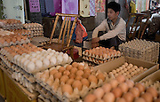 A vendor sells chicken eggs in a market in Longnan in Jiangxi Province, China.