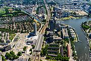 Nederland, Noord-Holland, Amsterdam, 29-06-2018; Overamstel en omgeving Amstelstation, Omval met rechts de Amstel met Rembrandt, Mondriaan en Breitner toren, links van het station het nieuwe Meininger Hotel. In de achtergrond Weespertrekvaart, voormalige Bijlmerbajes en nieuwbouw aan het Amstelkwartier (voormalige Zuidergasfabriek / Nuon terrein).<br /> Urban developement near Amstel railway station.<br /> luchtfoto (toeslag op standard tarieven);<br /> aerial photo (additional fee required);<br /> copyright foto/photo Siebe Swart