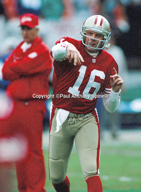 San Francisco 49ers quarterback Joe Montana (16) throws a pass during pregame warmups before the NFL NFC Championship playoff football game against the Dallas Cowboys on Jan. 17, 1993 in San Francisco. The Cowboys won the game 30-20. (©Paul Anthony Spinelli)
