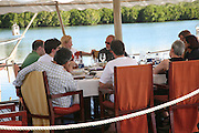 Judges meeting including Tilda Swinton and Tim Lott on the floating restaurant.  Preparing for the Le Prince Maurice Prize. Mauritius. 27 May 2006. ONE TIME USE ONLY - DO NOT ARCHIVE  © Copyright Photograph by Dafydd Jones 66 Stockwell Park Rd. London SW9 0DA Tel 020 7733 0108 www.dafjones.com