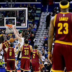 Dec 12, 2014; New Orleans, LA, USA; New Orleans Pelicans center Omer Asik (3) dunks over Cleveland Cavaliers center Anderson Varejao (17) as forward LeBron James (23) looks on from the back court during the second half of a game at the Smoothie King Center. The Pelicans defeated the Cavaliers 119-114. Mandatory Credit: Derick E. Hingle-USA TODAY Sports