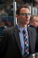 KELOWNA, CANADA -FEBRUARY 19: Dan Price, Assistant Coach of the Tri City Americans stands on the bench against the Kelowna Rockets on February 19, 2014 at Prospera Place in Kelowna, British Columbia, Canada.   (Photo by Marissa Baecker/Getty Images)  *** Local Caption *** Dan Price;