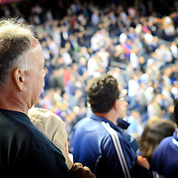 Crowd in Yankee Stadium singing the Anthem at the beginning of the baseball game. Bronx, New York City.