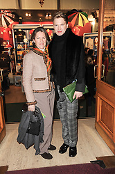 COLETTE CONWAY and her son HENRY CONWAY at the gala opening night of Cirque du Soleil's Varekai at the Royal Albert Hall, London on 5th January 2010.