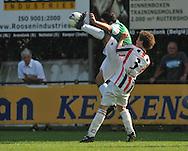 30-08-2008 VOETBAL:AUDAX JEUGDTOERNOOI 2008:TILBURG<br /> Sander van Buren van Willem II in duel met Anass Achabar van Feyenoord<br /> Foto: Geert van Erven