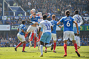Portsmouth Defender, Matt Clarke (5) wins a header to clear the ball during the EFL Sky Bet League 1 match between Portsmouth and Coventry City at Fratton Park, Portsmouth, England on 22 April 2019.
