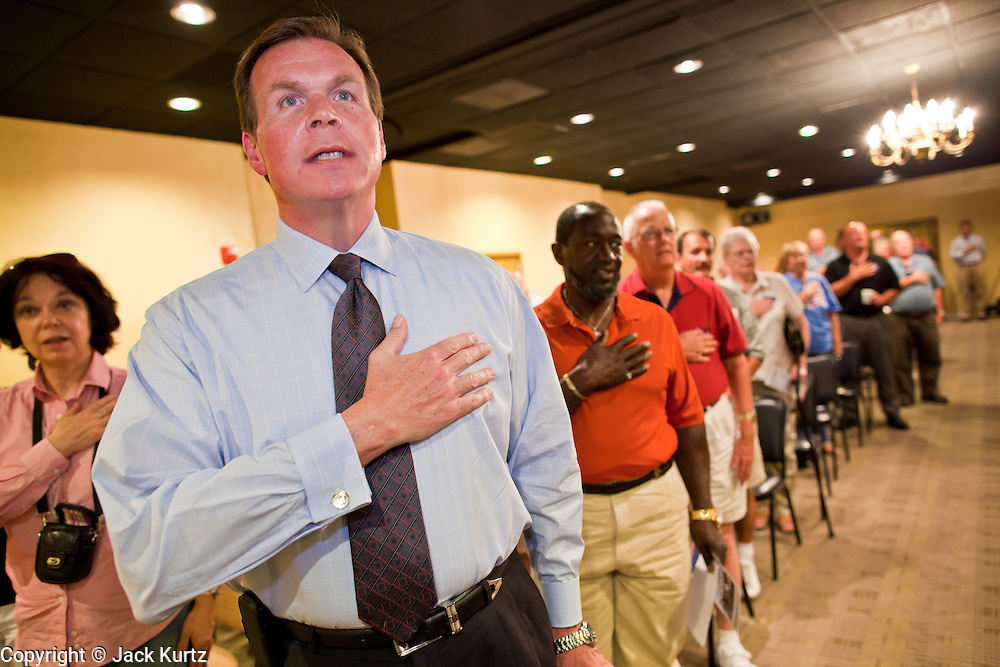 July 14 - PEORIA, AZ: JD HAYWORTH, a former Republican Congressman from Arizona, says the Pledge of Allegiance before a Tea Party meeting in Peoria, AZ. Hayworth spoke to the Tea Party gathering in a hotel meeting room in Peoria. Hayworth, an ultra conservative, is running to the right of long serving US Sen John McCain in the Arizona Republican US Senate primary. He has painted McCain as a moderate to liberal Senator in the mold John Kerry (D-MA).          Photo by Jack Kurtz