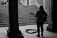 Street musician singing some of the last songs of the season at Bethesda Terrace in Central Park