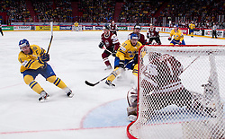 15.05.2012, Ericsson Globe, Stockholm, SWE, IIHF, Eishockey WM, Schweden (SWE) vs Lettland (LVL), im Bild Sverige Sweden 11 Daniel Alfredsson shoots, Sverige Sweden 27 Patric Hörnqvist // during the IIHF Icehockey World Championship Game between Schweden (SWE) vs Latvia (LVL) at the Ericsson Globe, Stockholm, Sweden on 2012/05/15. EXPA Pictures © 2012, PhotoCredit: EXPA/ PicAgency Skycam..***** ATTENTION - OUT OF SWE *****