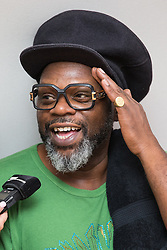 © Licensed to London News Pictures . 08/08/2015 . Siddington , UK . JAZZIE B ( Trevor Beresford Romeo OBE ) of SOUL II SOUL back stage at The Rewind Festival of 1980s music , fashion culture at Capesthorne Hall in Macclesfield . Photo credit: Joel Goodman/LNP