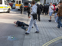 © Licensed to London News Pictures . 27/05/2013 . London , UK . An EDL supporter falls by the entrance to Downing Street . After the demonstration has ended , approximately 100 EDL supporters charge down Whitehall to Downing Street where police contain them by the gates . The EDL march along Whitehall and hold a demonstration opposite Downing Street today (Monday 27th May 2013) . Photo credit : Joel Goodman/LNP