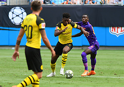 July 22, 2018 - Charlotte, NC, U.S. - CHARLOTTE, NC - JULY 22: Borussia Dortmund defender Dan-Axel Zagadou (2) battles for control of the ball during an International Champions Cup match between LiverPool FC and Borussia Dortmund on July 22 2018 at Bank Of America Stadium in Charlotte,NC.(Photo by Dannie Walls/Icon Sportswire) (Credit Image: © Dannie Walls/Icon SMI via ZUMA Press)