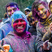 London, UK - 23 March 2013: people posing for picture during the Holi Spring Festival of Colour takes place at Orleans House Gallery in Twickenham. The annual event marks the end of Winter and welcomes the joy of spring.