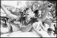 February 1986, Port-Au-Prince, Haiti --- Haitians Celebrating Jean-Claude Duvalier's Exile --- Image by © Owen Franken