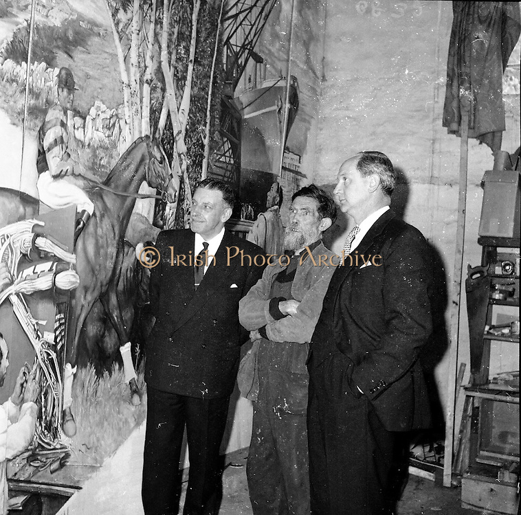 11/05/1961<br /> 05/11/1961<br /> 11 May 1961<br /> Taoiseach Sean Lemass and Minister for Industry and Commerce, Jack Lynch at artist Sean Keating's home, Ballyboden, Rathfarnham, Dublin.  to see the Irish Mural (250sq feet) for International Labour Organisation, to be presented to the International Labour Office in Geneva.