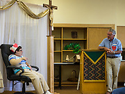 Deacon Bill Burkel helps direct a retreat for adults with cognitive disabilities. (Sam Lucero photo)