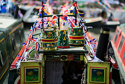 © Licensed to London News Pictures.30/04/2017.London, UK. Detail of watering cans on the roof of a narrowboat. Canalway Cavalcade festival takes place in Little Venice, London on Saturday, 30 April 2017. Inland Waterways Association's annual gathering of canal boats brings around 130 decorated boats together in Little Venice's canals on May bank holiday weekend. Photo credit: Ben Cawthra/LNP