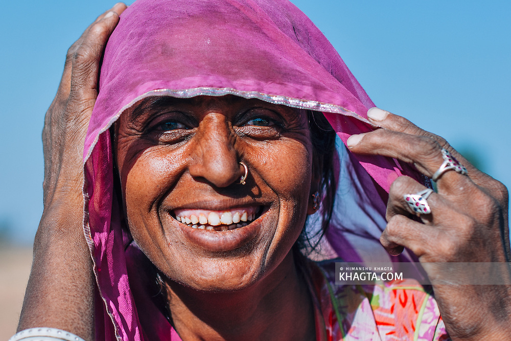 Portrait of a smiling Rajasthani Women with a veil on her head.