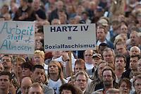 """30 AUG 2004, LEIPZIG/GERMANY:<br /> Demonstranten mit Schild """"Hartz IV = Sozialfaschismus"""", Montagsdemo gegen die Arbeitsmarktreformen, Hartz IV, Leipzig<br /> IMAGE: 20040830-01-030<br /> KEYWORDS: Demo, Demonstration, Demonstraten, demonstrator, Protest, Leipziger Montagsdemo"""